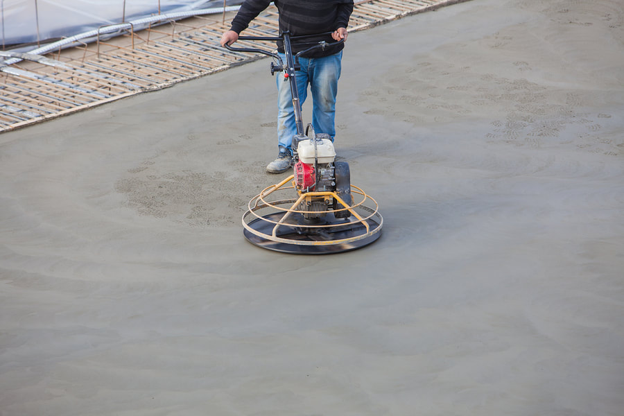 construction worker doing concrete polishing