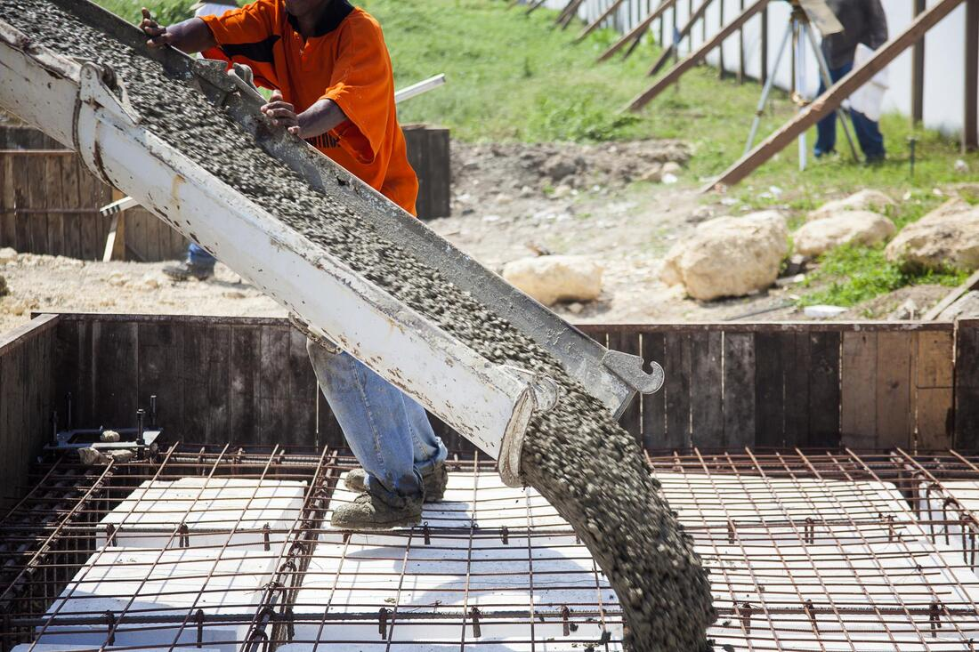construction worker doing concrete pouring