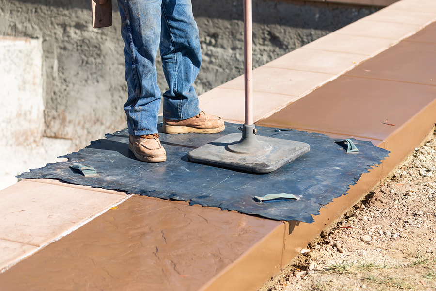 construction worker doing stamped concrete